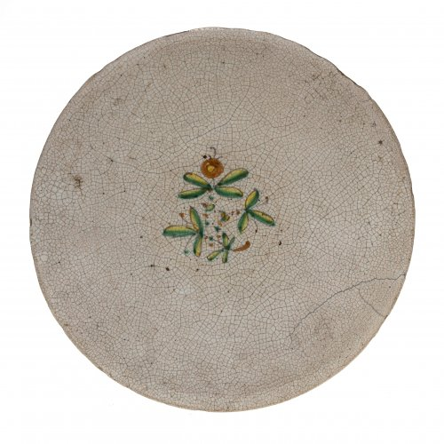Teller. Majolika. Craquelédekor mit florales Motiv. Italien, 18. Jh. ø26,5 cm.