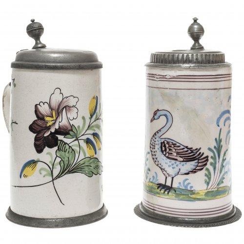 Zwei  Walzenkrüge. Deutsch, 18./19. Jh. Vogel und Blumendekor. Rep., besch. H. je ca. 23 cm.