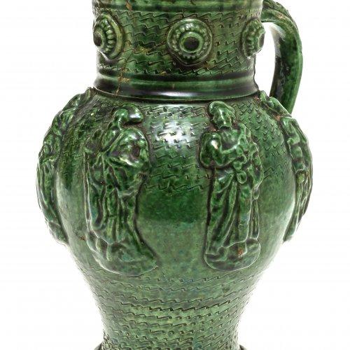 Bauchiger Krug, Irdenware, grün glasiert, Reliefdekor.
